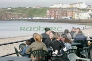 Tourists-sitting-on-plastic-furniture-on-Peel-seafront-Isle-Man-IOM