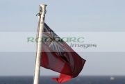 Red-ensign-the-UK-merchant-navy-flying-from-flag-pole-on-ship-at-sea.