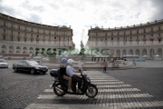 motor-scooter-with-rider-pillion-passenger-crosses-pedestrian-crossing-on-Piazza-Della-Republica-Rome-Lazio-Italy