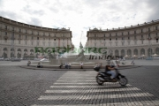 motor-scooter-with-rider-crosses-pedestrian-crossing-on-Piazza-Della-Republica-Rome-Lazio-Italy