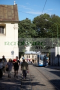 new-electric-public-transport-tram-on-the-old-town-stare-miasto-cobbled-street-with-pedestrians-in-krakow
