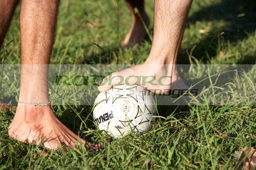 barefoot football in the park