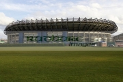 Murrayfield-Rugby-sports-stadium-with-green-grass-blue-cloudy-sky,-Edinburgh,-Scotland,-UK