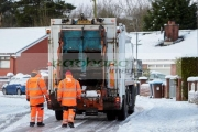 workers-with-refuse-recycling-collection-truck-driving-along-street-covered-in-snow-in-newtownabbey-northern-ireland