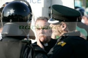Fr-Aidan-Troy-speaks-to-PSNI-officers-on-crumlin-road-at-ardoyne-shops-belfast-12th-July
