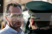 Sinn-Fein-MLA-Gerry-Kelly-talks-to-PSNI-police-officer-on-crumlin-road-at-ardoyne-shops-belfast-12th-July