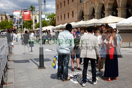 african immigrant street sellers selling sunglasses to tourists barcelona catalonia spain