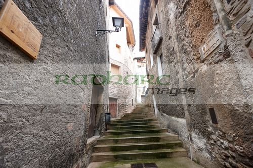narrow medieval street carrer forment baga catalonia spain