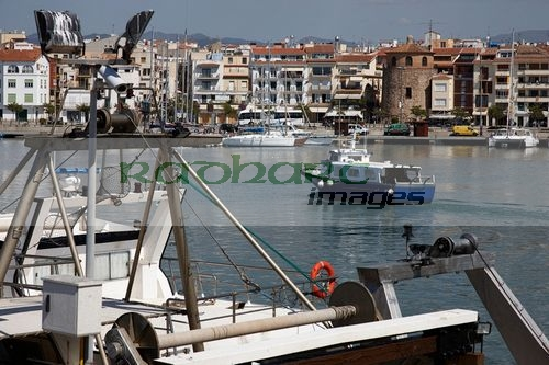 small sardine and bluefish trawlers in the port harbour of Cambrils Catalonia Spain