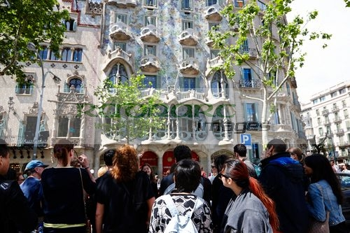 tourists tour group outside casa batllo modernisme style building in Barcelona Catalonia Spain