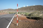 red-white-road-snow-level-marker-on-the-side-the-road-in-Teide-National-Park-Tenerife-Canary-Islands-Spain