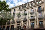 ornate-balconies-design-pension-building-25-las-ramblas-on-la-rambla-dels-caputxins-barcelona-catalonia-spain