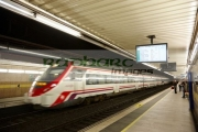 renfe-civia-train-speeding-through-passeig-de-gracia-underground-main-line-train-station-Barcelona-Catalonia-Spain