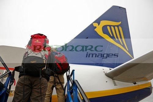 passengers with baggage boarding ryanair flight at dublin airport terminal 1 ireland