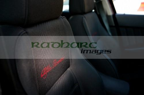 Alfa Romeo dark seats with embroidered writing in a 156