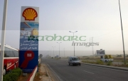 cars-going-past-shell-garage-sign-on-highway-service-station-outside-sousse-in-tunisia
