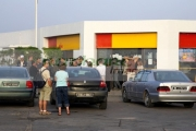 locals-tourists-stand-outside-service-station-shop-in-garage-forecourt-on-highway-outside-Sousse-in-Tunisia