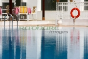 steps-red-lifebelt-reflection-in-still-blue-swimming-pool-in-resort-hotel-hammamet-tunisia