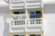 clothes-drying-in-hot-summer-sun-on-balconies-tourist-hotel-rooms-in-hotel-in-hammamet-tunisia