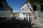 street-sighs-the-oldest-street-in-the-Barrio-Historico-Colonia-Del-Sacramento-Uruguay-South-America-The-street-is-portuguese-in-design-with-the-drain-in-the-middle-old-colonial-houses