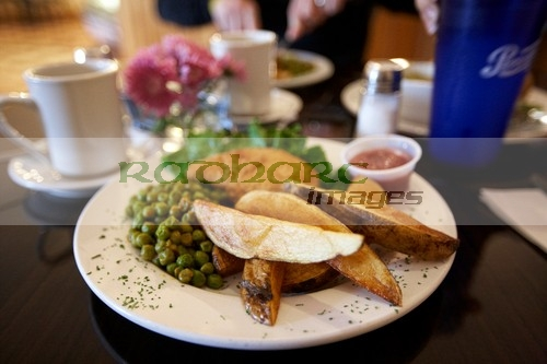 meal-fresh-potato-wedges-peas-chicken-in-restaurant-in-the-usa