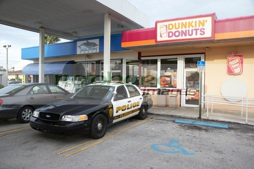 Cop car outside a donut shop