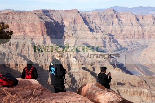 teenagers standing on the edge of the Grand Canyon at Guano Point