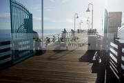 people-fishing-early-morning-off-daytona-beach-pier-florida-usa