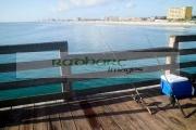two-fishing-rods-cooler-on-daytona-beach-pier-florida-usa